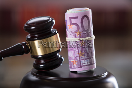 close up of gavel and banknote