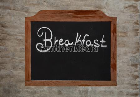 chalk word breakfast on vintage blackboard