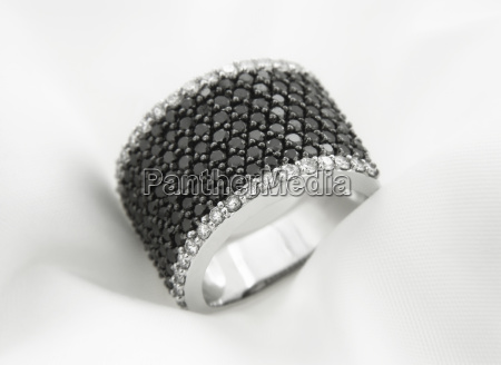 white gold ring with black and