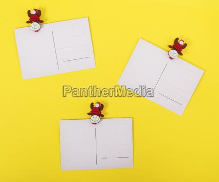 three empty vintage paper postcards on