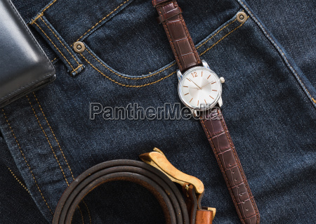 wristwatch, and, wallet, on, denim, jeans - 23448115
