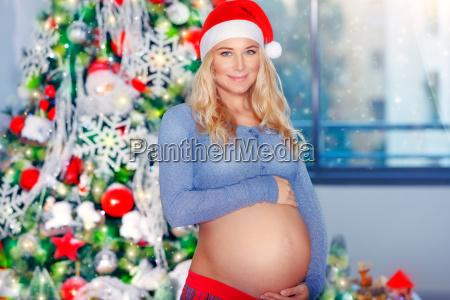 pregnant woman celebrate christmas