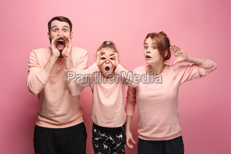 surprised young family looking at camera