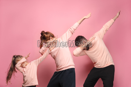 the, dancing, young, family, on, pink - 23452659