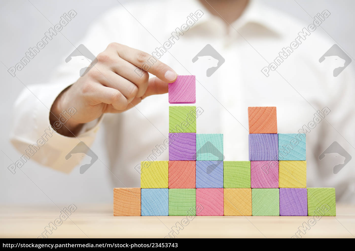 man's, hand, stacking, colorful, wooden, blocks. - 23453743