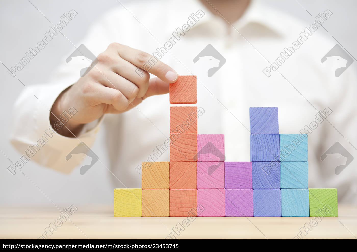 man's, hand, stacking, colorful, wooden, blocks. - 23453745