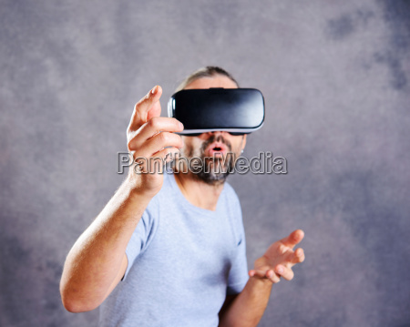 man with virtual reality glasses pointing