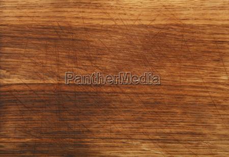 close up dark oak wood board