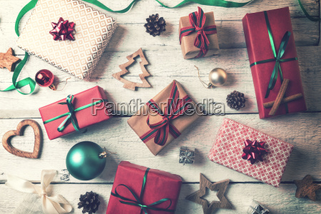 christmas gifts and decorations on white