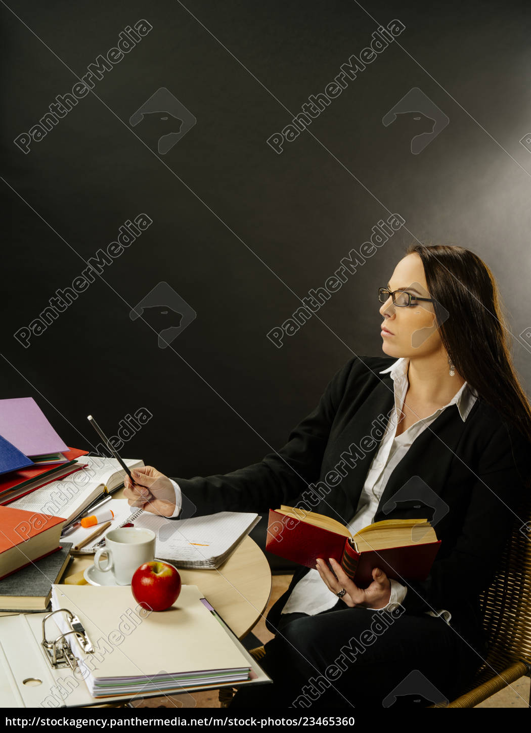 woman, sitting, at, her, desk, writing - 23465360