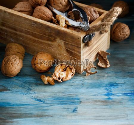 fresh walnuts in a box on