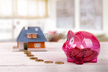 conceptual shot with piggy bank and