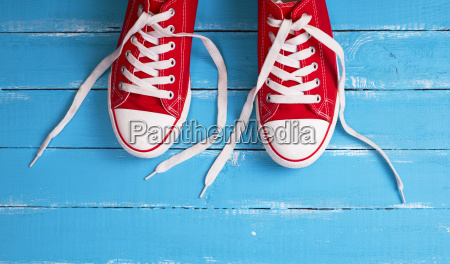 pair of red sneakers with