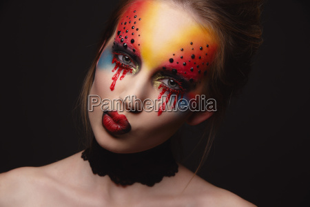 young female model with bloody eyes