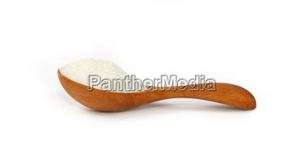 wooden scoop spoon full of white