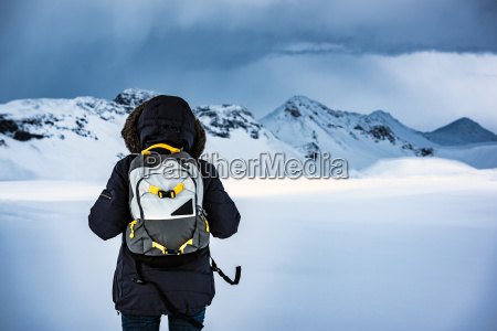 traveler enjoying winter landscape