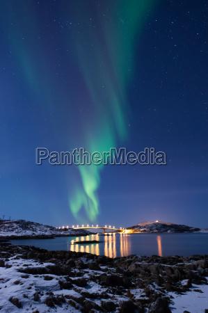 northern light over bridge at senja