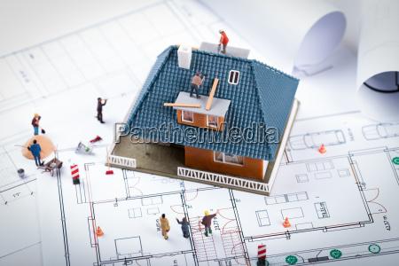 house construction project concept building scale