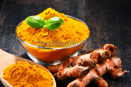 composition, with, bowl, of, turmeric, powder - 23492131