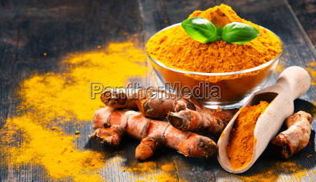 composition, with, bowl, of, turmeric, powder - 23492149