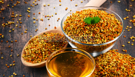 bowls with bee pollen and honey