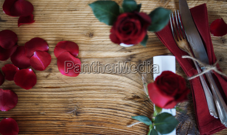 table decoration with red roses