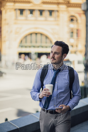 millennial businessman commuting in melbourne