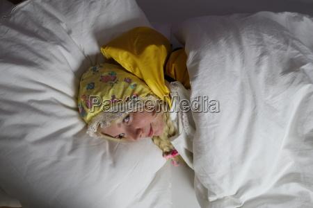 a rainwear maid lying in bed