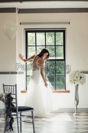 beautiful, bride, posing, at, the, window - 23516774