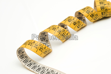 a yellow tape measure for tailor
