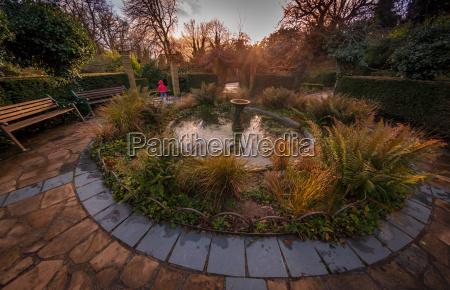garden fountain at sunset