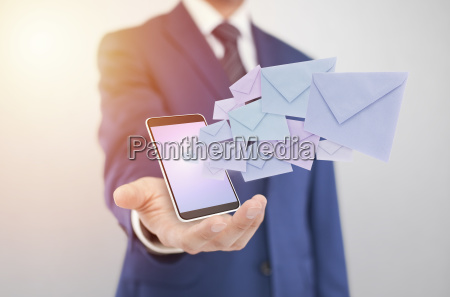 businessman, with, smartphone, with, envelopes, coming - 23524850