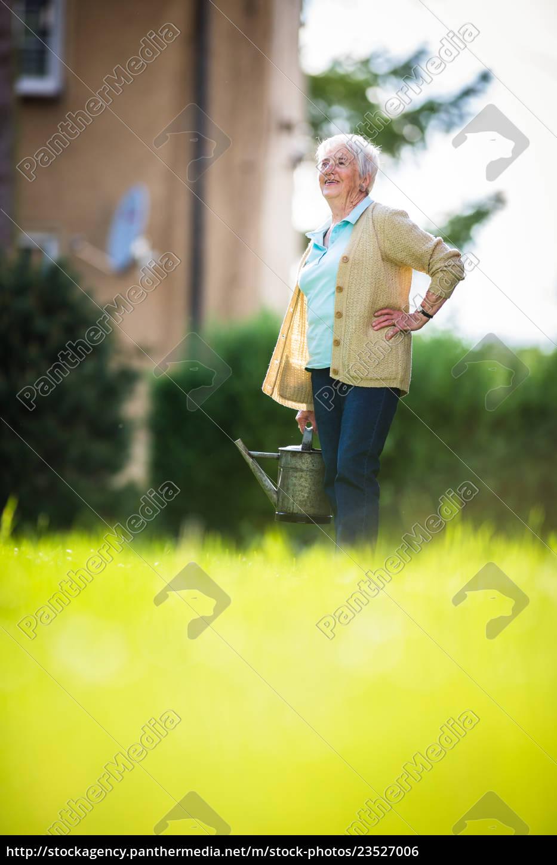 senior, woman, doing, some, gardening, in - 23527006
