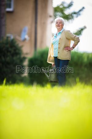 senior, woman, doing, some, gardening, in - 23527008