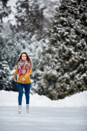 young, woman, ice, skating, outdoors, on - 23527066