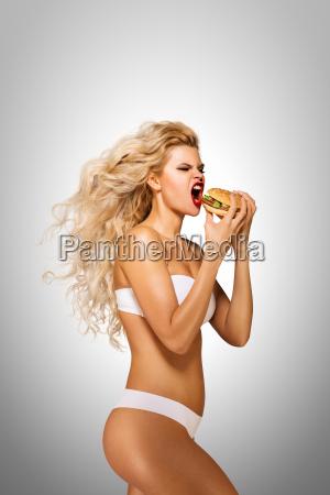 eating, burger. - 23538788