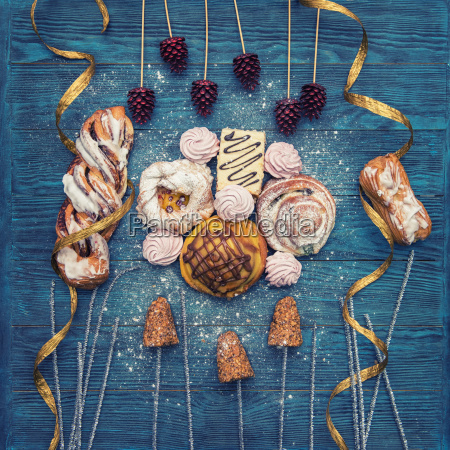 different, cookies, on, blue, wooden - 23544158