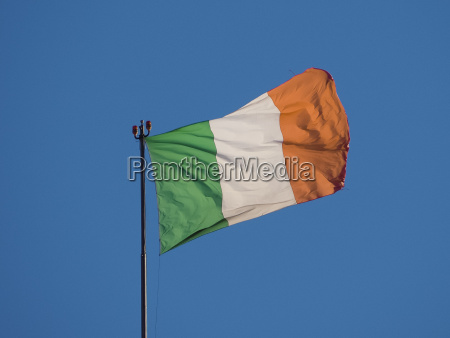 irish flag of ireland over blue