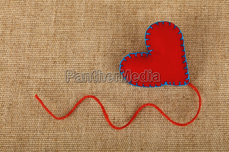 red felt craft heart over canvas