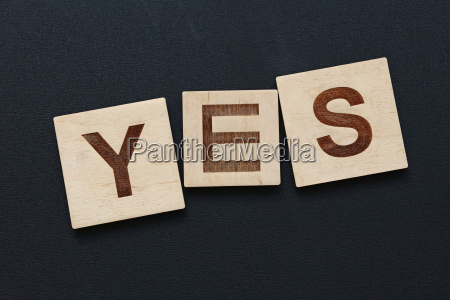 word yes on wooden signs over
