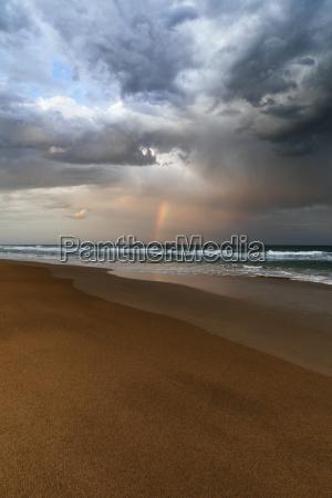 beach and ocean landscape with rainbow