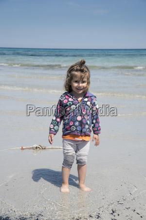 smiling young girl at cala brandinchi