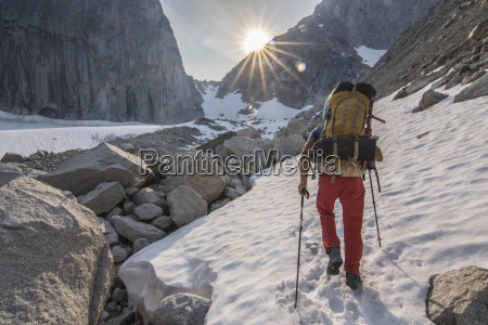 mountain climber on approach to bugaboo