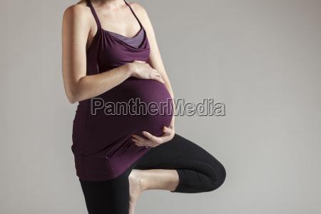 woman doing prenatal yoga in tree