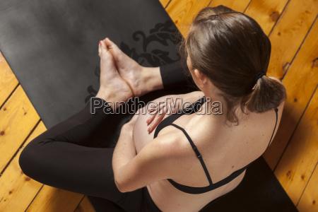 woman doing prenatal yoga in lotus