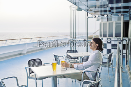 young man having a beer on