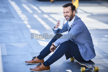 businessman drinking coffee and sitting on