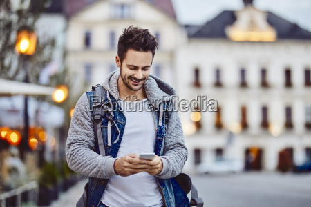 man using phone at the evening