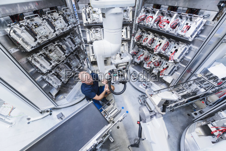 man working at industrial robot in