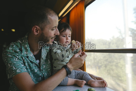 father giving a cookie to his